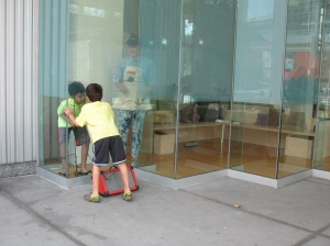 young visitors playing with communicating through the windows