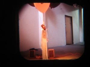 Rafaelito floats with balloons